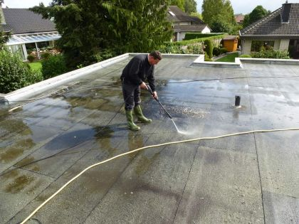 Roof waterproofing: the first step is cleaning the roof with pressurized water
